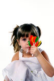 My suckers. A young girl holding a handful of suckers royalty free stock photos