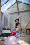 My sweet home. Little girl in her wood house for playtime stock photography