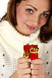 My Sweet Little Present. Pretty Young Woman Holding A Small Red Present Box Royalty Free Stock Image