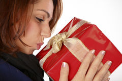 My Sweet Present. Happy Young Woman Kissing Her Christmas Present Royalty Free Stock Photos