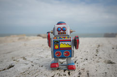 My sweet tin toy robot on the rocks Royalty Free Stock Images