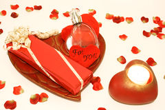 For my sweetheart. Romantic gift with candle and petals Stock Images