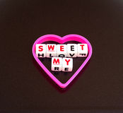 My sweetheart. Text  my sweet  in uppercase letters on small white cubes surrounded by a pink heart shape making concept of my sweetheart Royalty Free Stock Photo