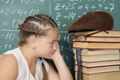 My teachers. It is my books, schoolgirl looking into the eyes of his teacher Royalty Free Stock Images
