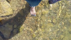 My blue toes. Walking in lake water stock photography