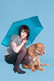 This is my umbrella. Young girl and her dog both holding un umbrella Royalty Free Stock Photos