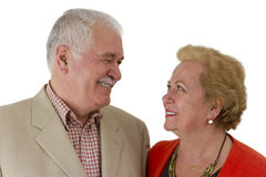 My Valentine. Senior couple looking at eachother trustfully and happly both toothy smiling Royalty Free Stock Image