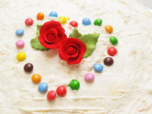 My Valentine-Roses. Roses and heart symbol on cake Stock Image