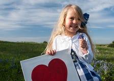 My Very Own. Little girl in a bluebonnet flower field in Texas stock images