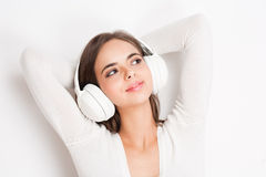 My vibe. Portrait of a gorgeous young brunette listening to music in headphones royalty free stock images