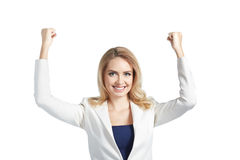 It is my victory. Happy beautiful woman keeping arms raised Royalty Free Stock Photos