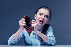My Wallet is Empty . Young attractive businesswoman showing an empty wallet to the camera Stock Photos
