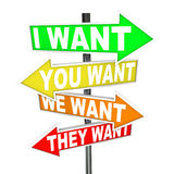 My Wants and Needs Vs Yours - Selfish Desires on Signs. Several colorful arrow street signs with the words I Want, You Want, We Want, They Want representing a Stock Photos