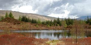 On my way. Along the west highland way, Scotland, by a small lake next to Tyndrum Stock Image