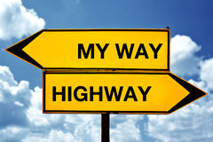 My way or the Highway, opposite signs. Two opposite signs against blue sky background stock photo