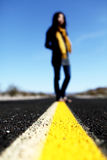 My way -- a lady standing in the middle of the road. Stock Photo