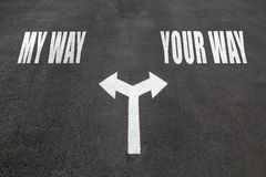 My way vs your way choice. Concept, two direction arrows on asphalt Stock Photo