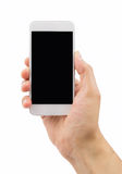 My white phone vertical. Hand holding a modern smartphone with white background Stock Photography