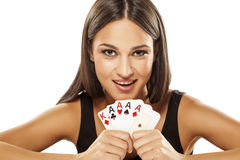 My win. Happy attractive girl holding the winning combination of poker cards Royalty Free Stock Images