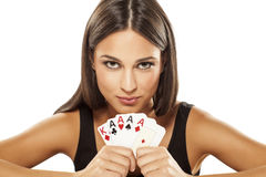 My win. Happy attractive girl holding the winning combination of poker cards royalty free stock image