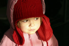 In my winter cap. Little girl wearing big, red, winter cap Royalty Free Stock Image
