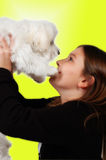 My Wish. Littel girl holds up her present, it's a Maltese puppy that she always wanted Royalty Free Stock Photography