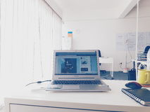My Workstation. My laptop in my office. Looks white and clean Stock Photography