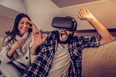 Emotional nice man having a feeling of fear. My worst nightmare. Emotional nice men having fear while seeing something scary in the virtual reality royalty free stock photos