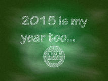 2015 is my year too. The words 2015 is my year too next to a drawing of a smiley face on a blackboard Stock Photography