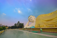 Mya Tha Lyaung Reclining Buddha with interesting sky colour approaching sunset Stock Photo