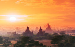 Myanmar Bagan historical site on magical sunset. Burma Asia. Myanmar Bagan historical site on magical sunset with beautiful sky and Buddhist temples panoramic royalty free stock image