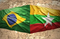 Myanmar and Brazil. Waving Myanmar and Brazilian flags of the political map of the world Royalty Free Stock Image