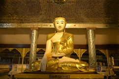 Myanmar Buddha image. Style of the Buddha image was popular. In this style  exaggerated eyebrows that curve upward, half-closed eyes, thin lips and a hair bun Stock Photo