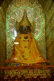 Myanmar Buddha image. Style of the Buddha image was popular. In this style  exaggerated eyebrows that curve upward, half-closed eyes, thin lips and a hair bun Stock Images