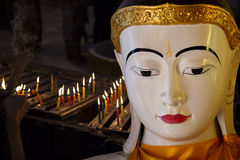Myanmar, Buddha statue and candles Stock Photo
