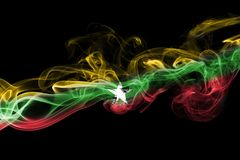 Myanmar, Burma flag smoke isolated on a black background. Myanmar, Burma smoke flag isolated on a black background Stock Image