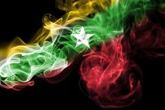 Myanmar, Burma flag smoke. Myanmar, Burma smoke flag isolated on a black background Stock Photo