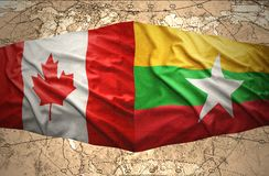 Myanmar and Canada. Waving Myanmar and Canadian flags of the political map of the world Stock Images