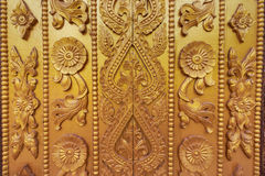 Myanmar carving on golden wall. stock image