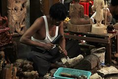 Myanmar is carving a wooden Buddha. stock image