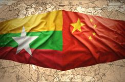 Myanmar and China. Waving Myanmar and Chinese flags of the political map of the world Stock Image