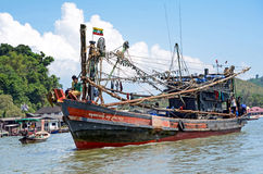 Myanmar fishing boat in Thai sea near Ranong fish market. Royalty Free Stock Images
