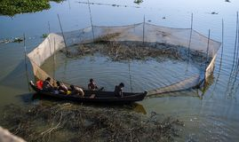 Myanmar Fishing style U Bein Bridge. Amarapura, Mandalay/Myanmar Fishermen under the U Bein Bridge is a teak bridge located on Taungthaman Lake in Amarapura near Stock Photo