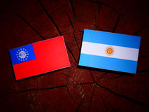 Myanmar flag with Argentinian flag on a tree stump  Royalty Free Stock Images