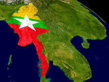 Myanmar with flag on Earth Stock Images