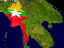 Myanmar with flag on Earth Stock Photography