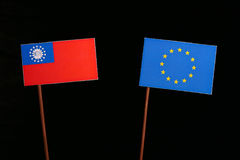 Myanmar flag with European Union EU flag isolated on black. Background Royalty Free Stock Images