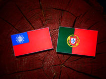 Myanmar flag with Portuguese flag on a tree stump isolated. Myanmar flag with Portuguese flag on a tree stump royalty free illustration