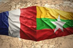Myanmar and France. Waving Myanmar and French flags of the political map of the world Royalty Free Stock Photos