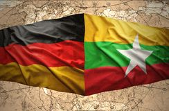 Myanmar and Germany. Waving Myanmar and German flags of the political map of the world Royalty Free Stock Images